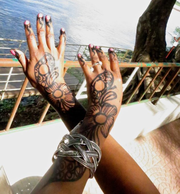 Pictured above is henna tattoo design on hands and arms