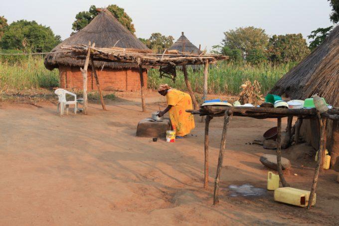 Grass hut, clay stove, home compound, South Sudan Village