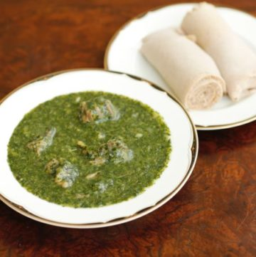 Pictured above is Molokhia cooked in lamb meat, ready to eat, with Injera. South Sudanese Cuisine.