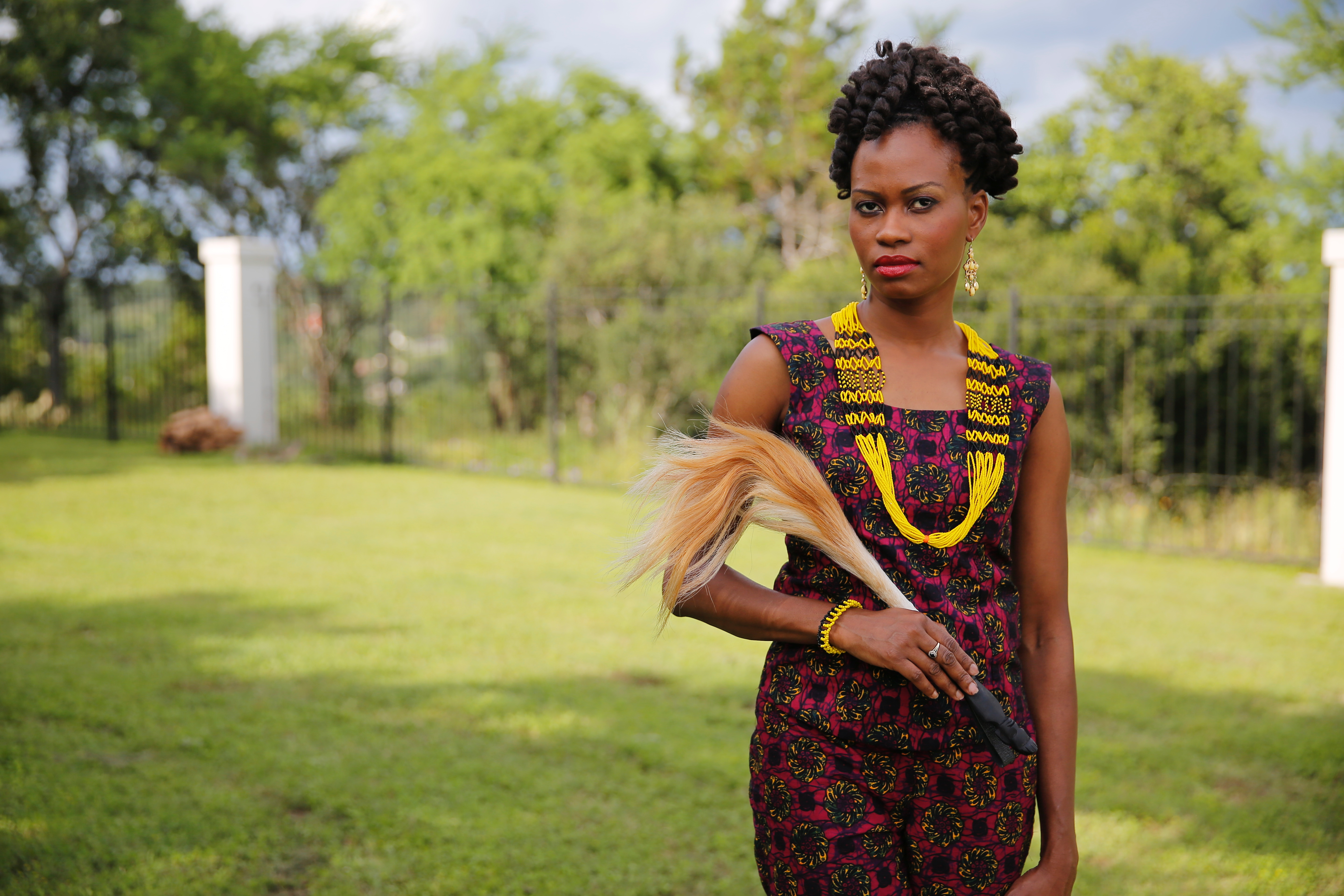 Noela Mogga in African print and South Sudanese beaded necklace and bracelet