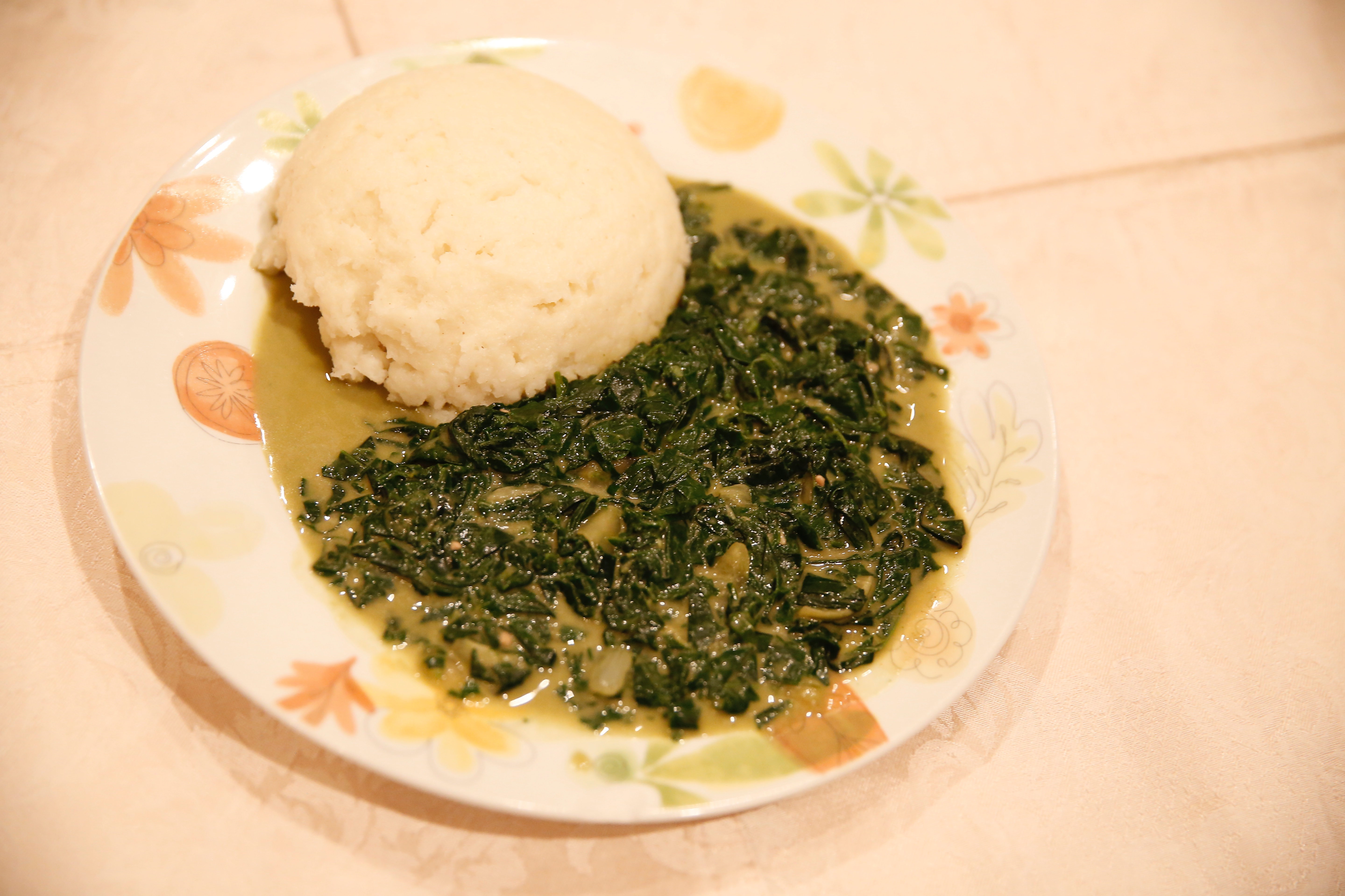 Nyete with peanut butter, served with Asida