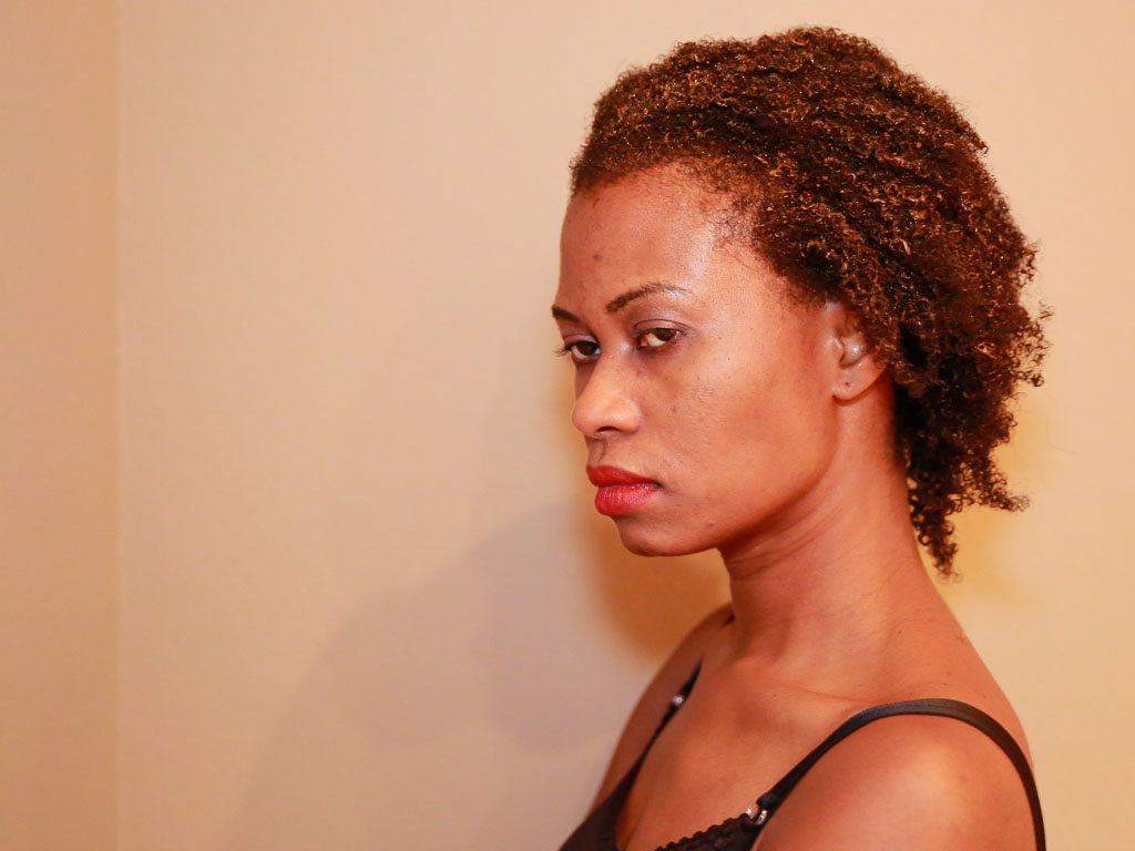 Pictured above is a model with henna conditioner applied to hair.