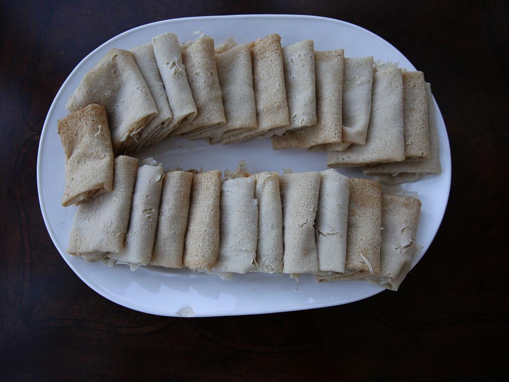 Kisra, individual kisra leaves folded for serving. South Sudanese food. Sudanese food.
