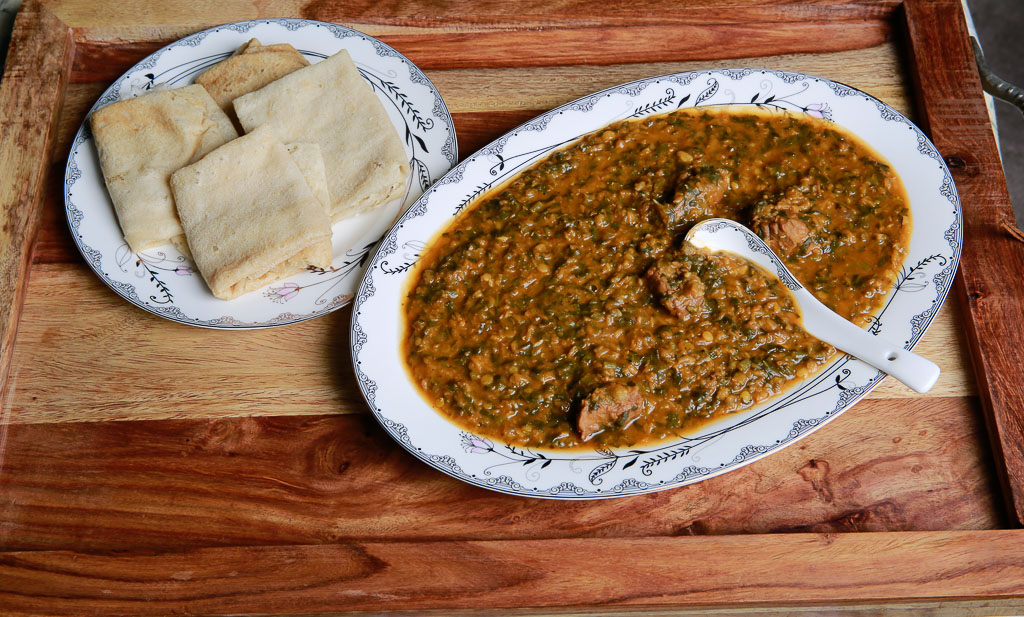 Rijla; purslane with red lentils stew serve with Kisra