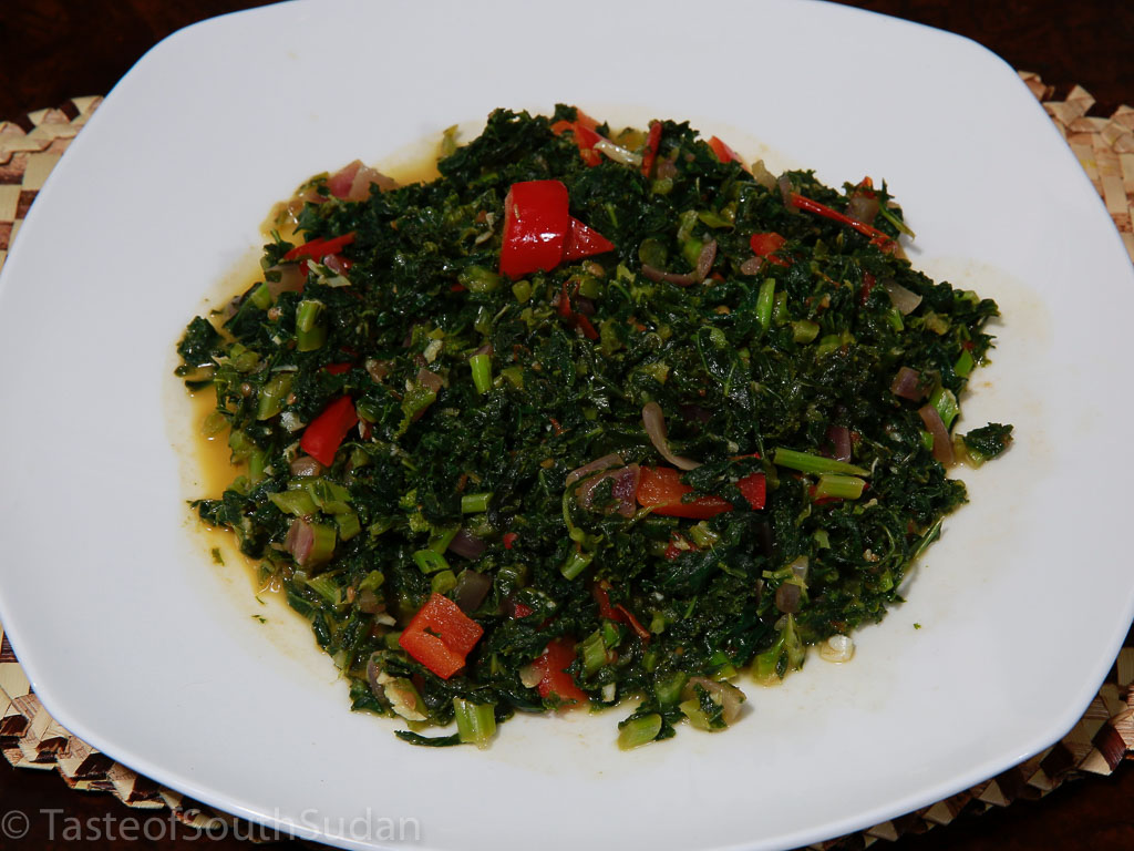 Pictured above is a dish of sukuma wiki, kale recipe, South Sudanese food, Kenyan food