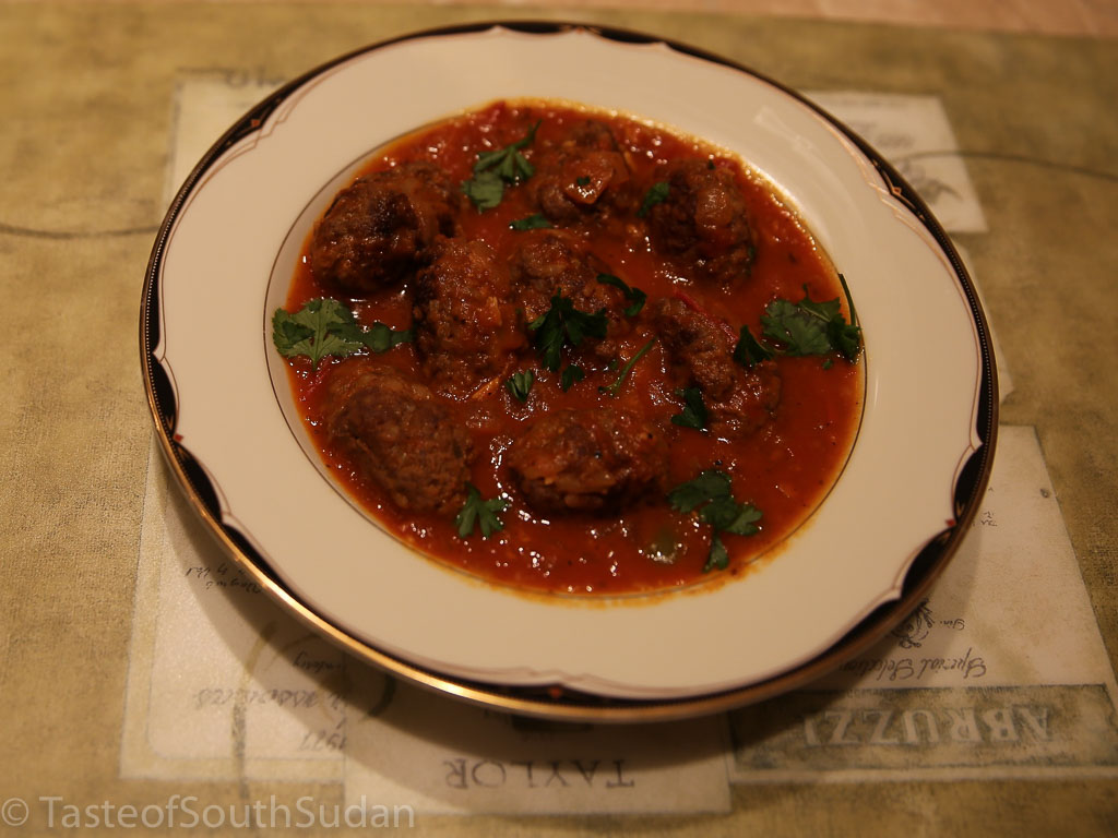 Picture above is kofta, spicy minced meatballs in tomato sauce. South Sudan food, Sudanese food, North African cuisine.