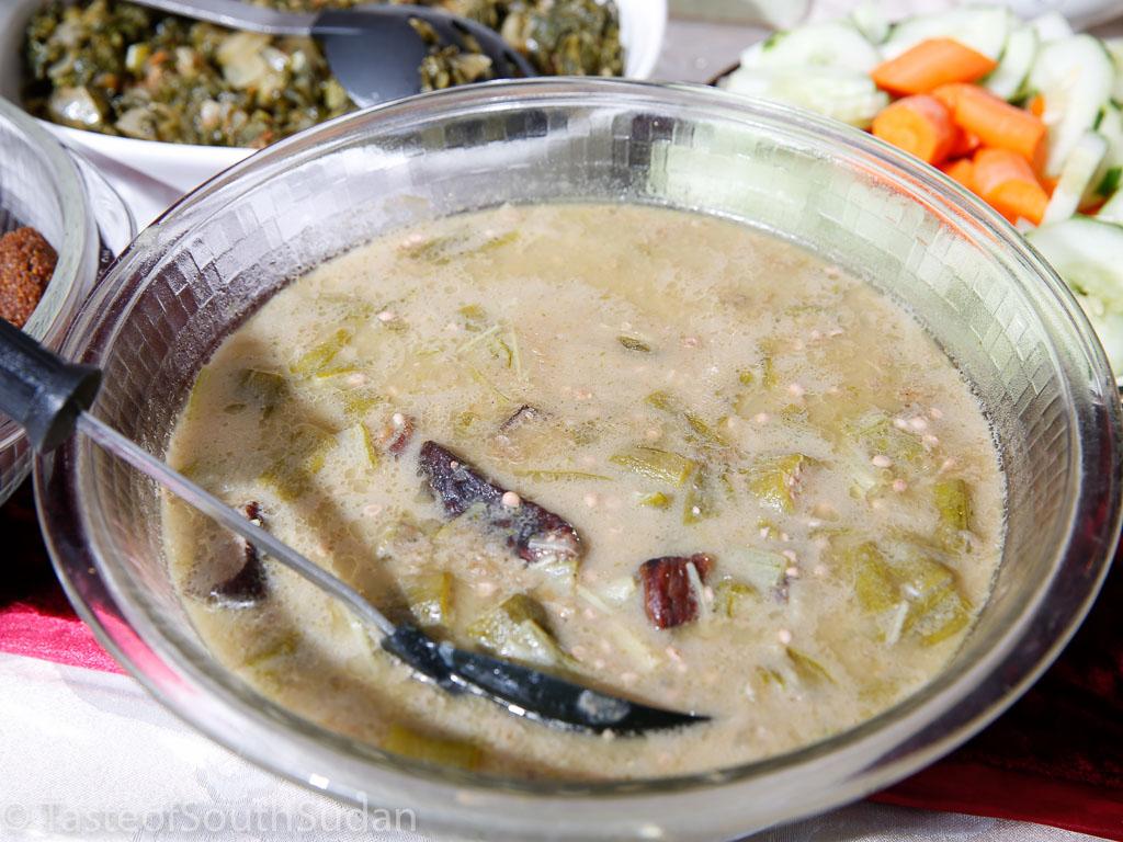 Mula Kombo ta bamia: smoked meat and okra cooked with traditional salt Kombo and peanut butter.