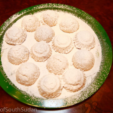 Kahk, filled with dates, dusted with icing sugar.