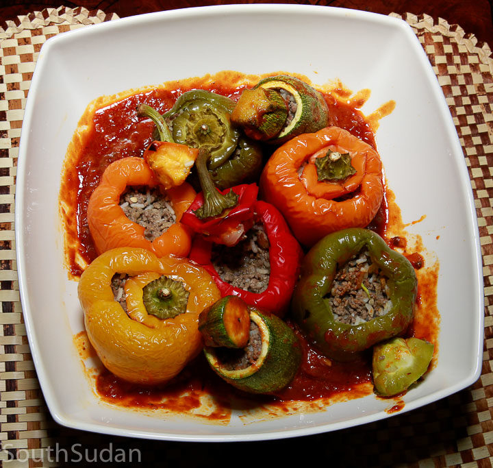 Mahshi, roasted stuffed zucchini and bell peppers, in a bed of tomato sauce. South Sudan food, Sudanese cuisine, North Africa, and Mediterranean cuisine.
