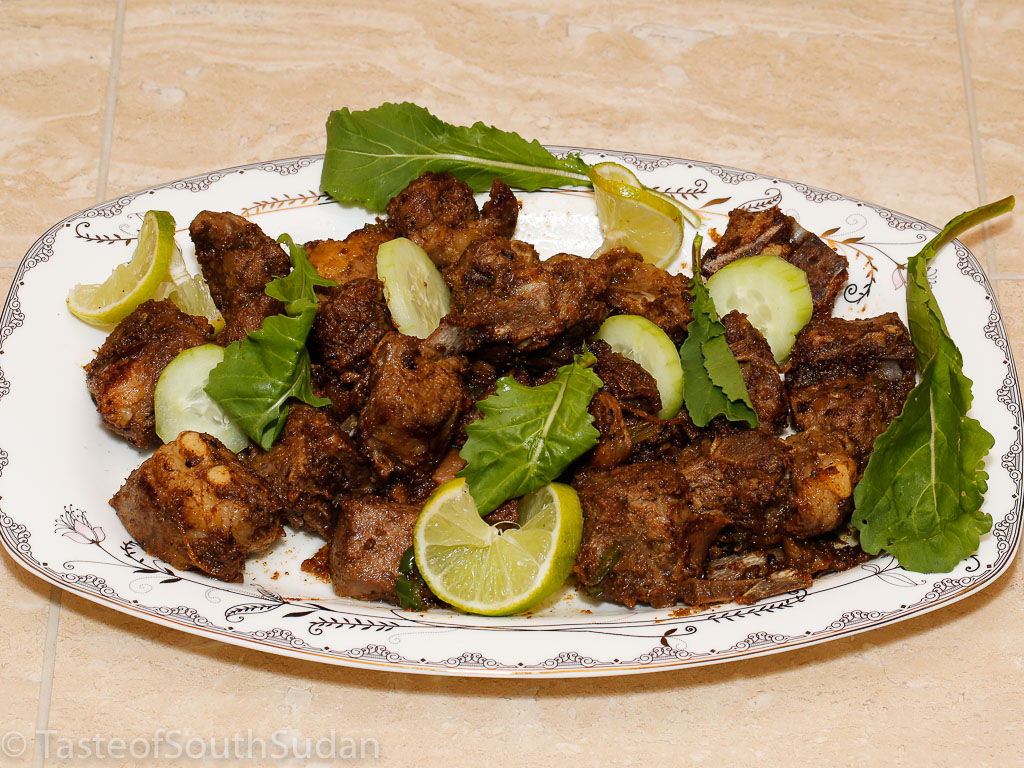 Pictured above is roasted lamb, called Shaiyah. Recipe from Taste of South Sudan, Sudanese food, South Sudanese food